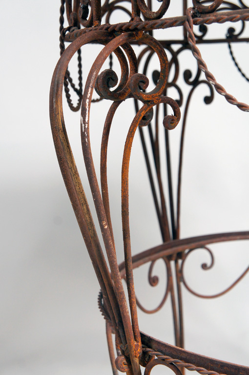 Pair of French Iron Tables with marble tops.