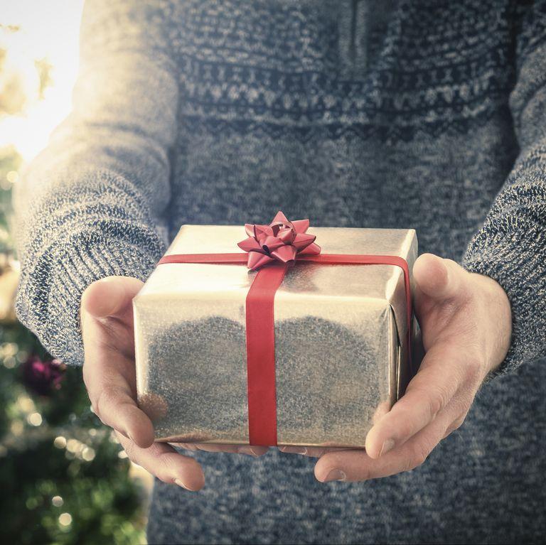 Person giving Christmas gift