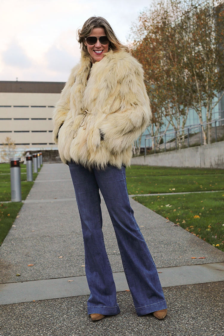 fur coat with flared jeans for a '70s look