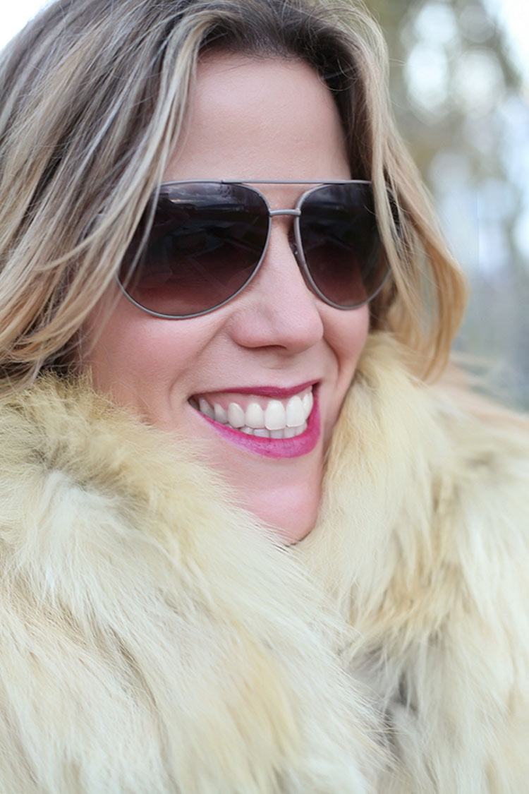 Aviator sunglasses and fur for a '70s look
