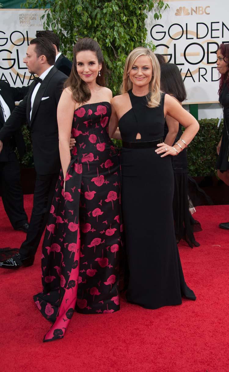 Tina Fey in Carolina Herrera and Amy Poehler in Stella McCartney at the Golden Globes