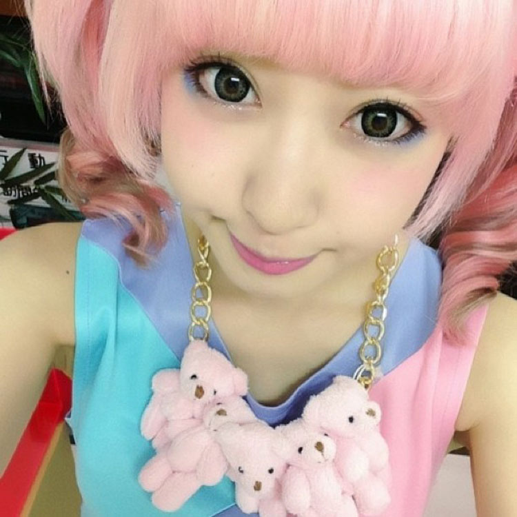 Singer Kimura U wearing an Onch Teddies necklace by Onch Movement