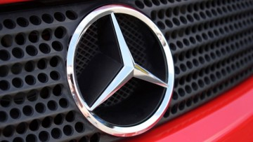 1472872251_mercedes-logo-on-car-front-iphone-1440x900