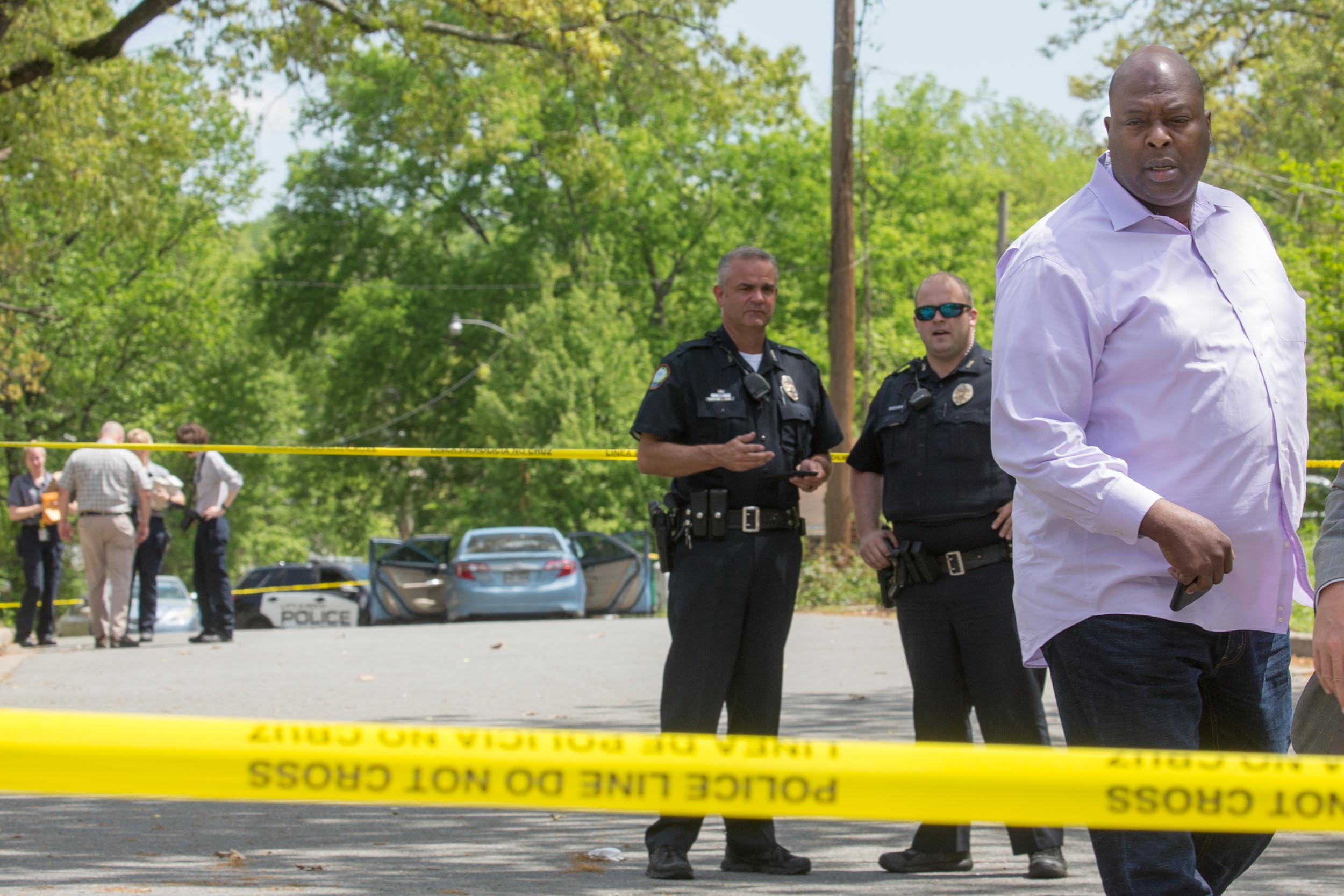 Former Little Rock Police Chief Kenton Buckner walks past crime scene tape at the scene of a double shooting at 27th Street and Washington Street after two 16-year-olds were shot while driving a stolen car April 9, 2017.