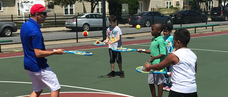 Kids working on Tennis Skills