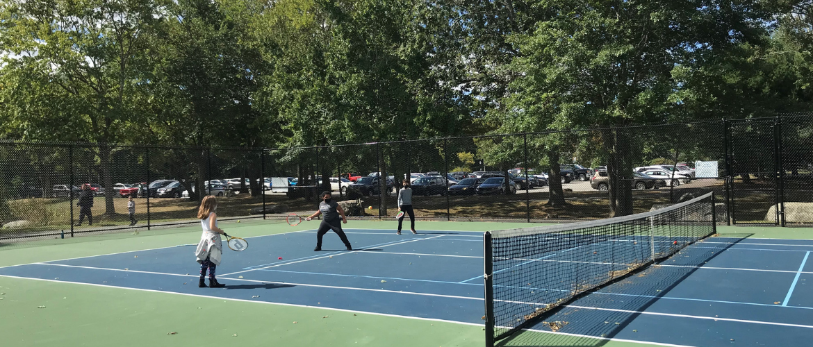 Youth Playing Tennis