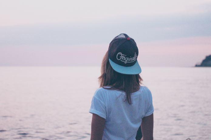 impostor syndrome - girl wearing hat