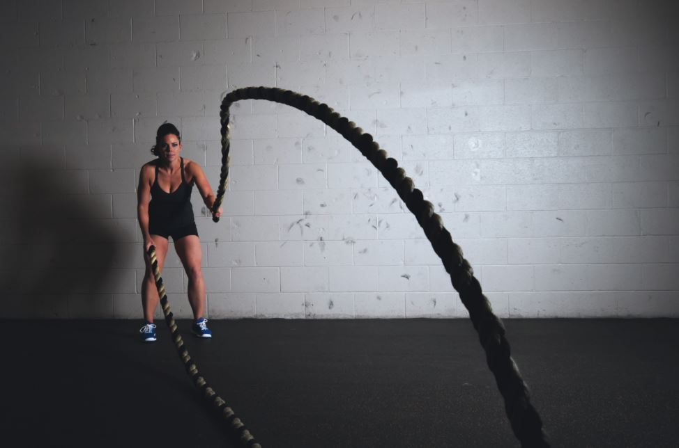 starting a personal training business - woman with ropes