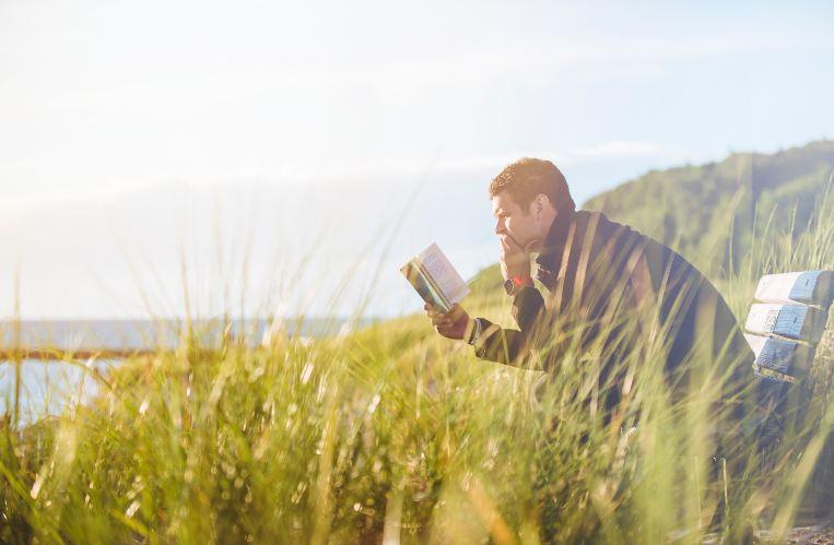 man reading - global growth mindset