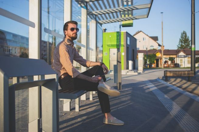 becoming an entrepreneur - man at bus stop