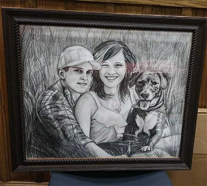 a charcoal drawing of a family with a dog in a field
