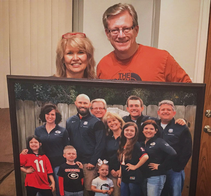 an oil painting of huge family phot