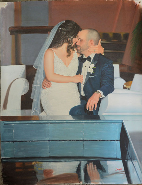 a custom oil painting of a bride embracing her husband