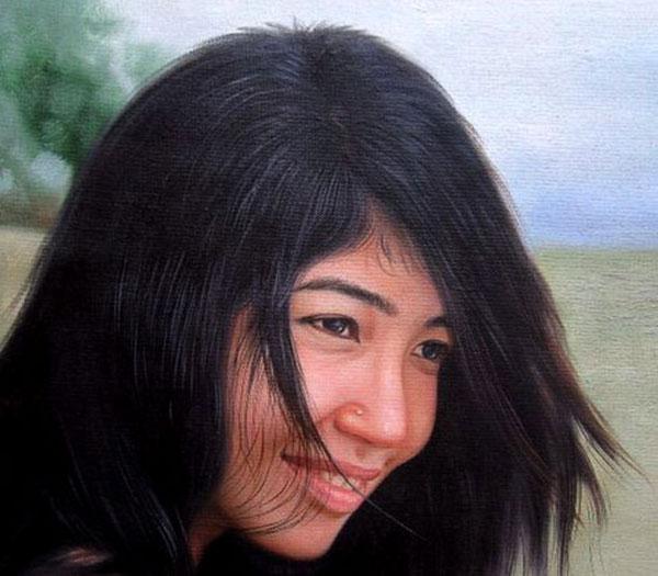 Beautiful oil portrait self girl on a beach windy hair