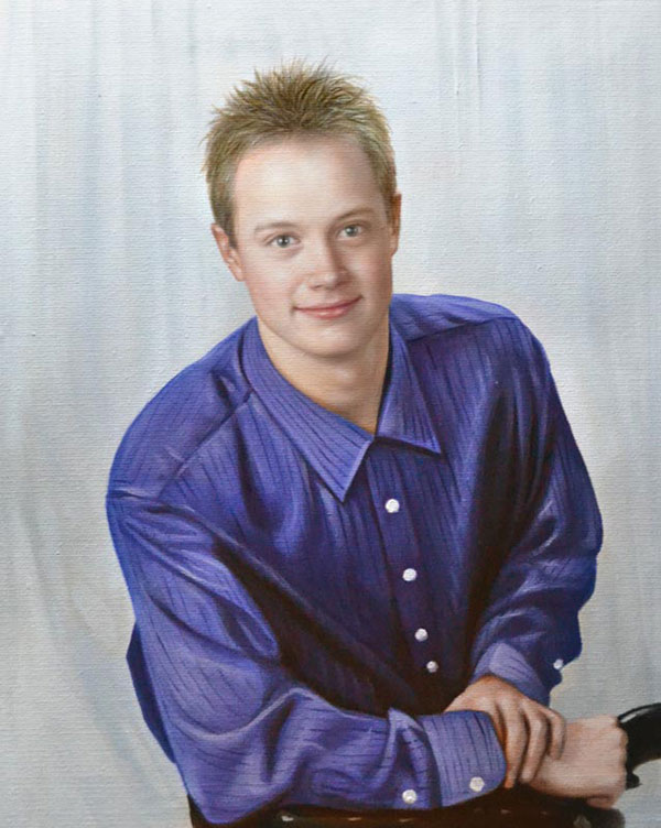 a custom oil portrait of a young man in blue shirt