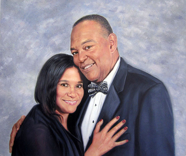 picture to painting of elder black couple hugging