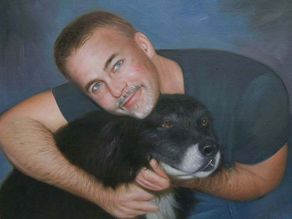 Handmade oil painting of a man hugging his dog
