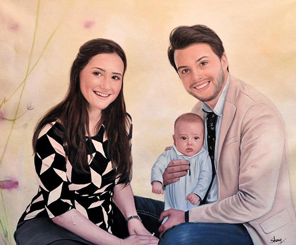 a custom oil paintng of a family with a newborn