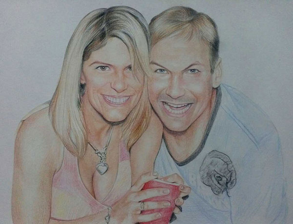 custom colored pencil drawing of a couple hugging and smilin