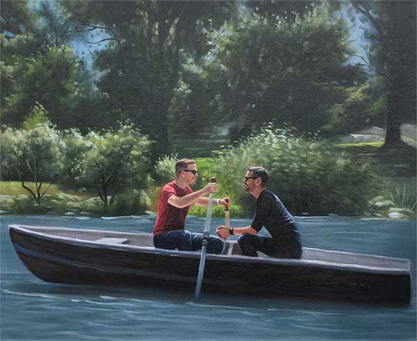 male couple in a bout on a lake romantic