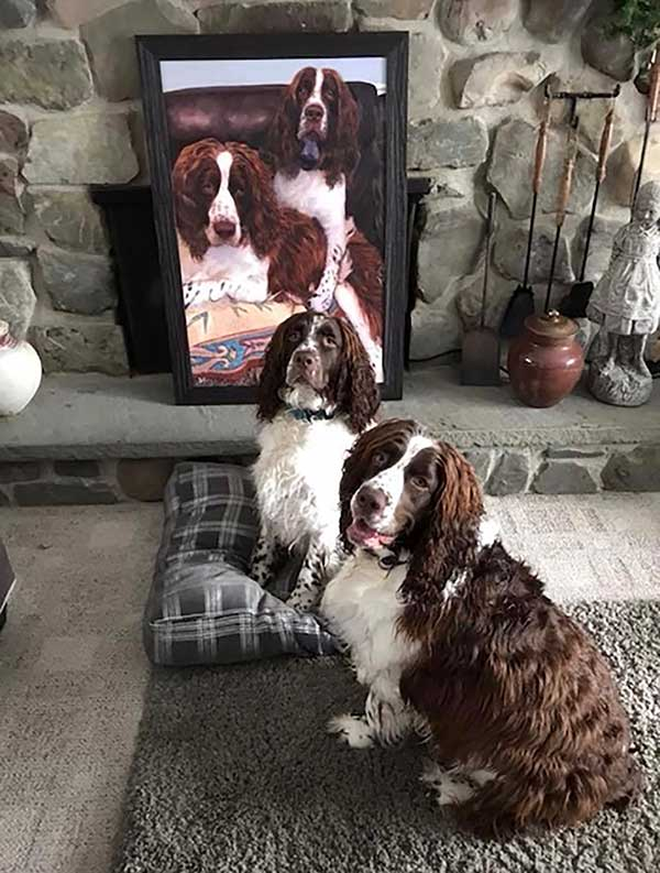 an oil painting of two black and brown dogs sitting in the sofa