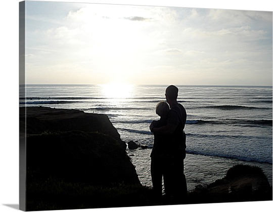 Canvas Print of Couple during Sunrise on Beach