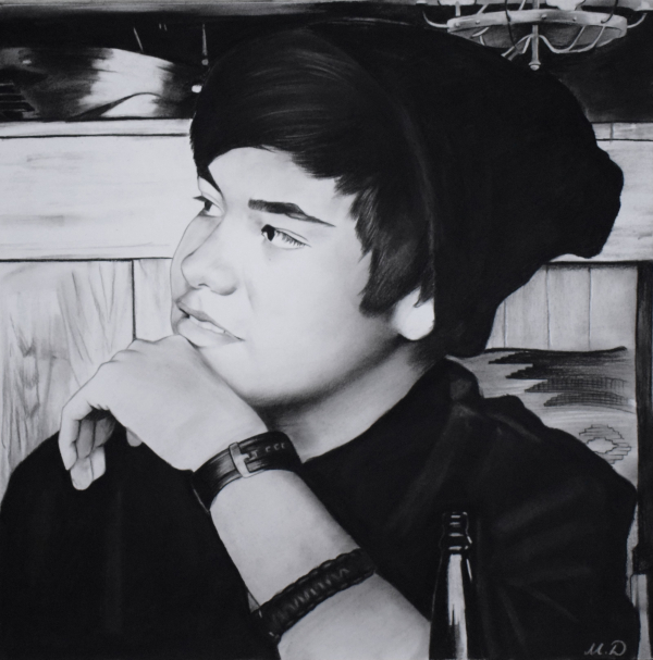 custom charcoal profile portrait of a man in a beanie