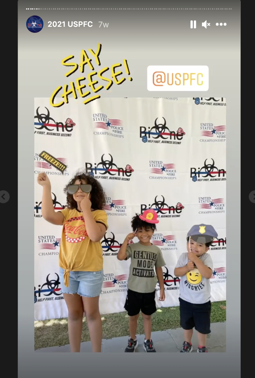 Family enjoying props at the Bio-One booth at the U.S. Police and Fire Championships
