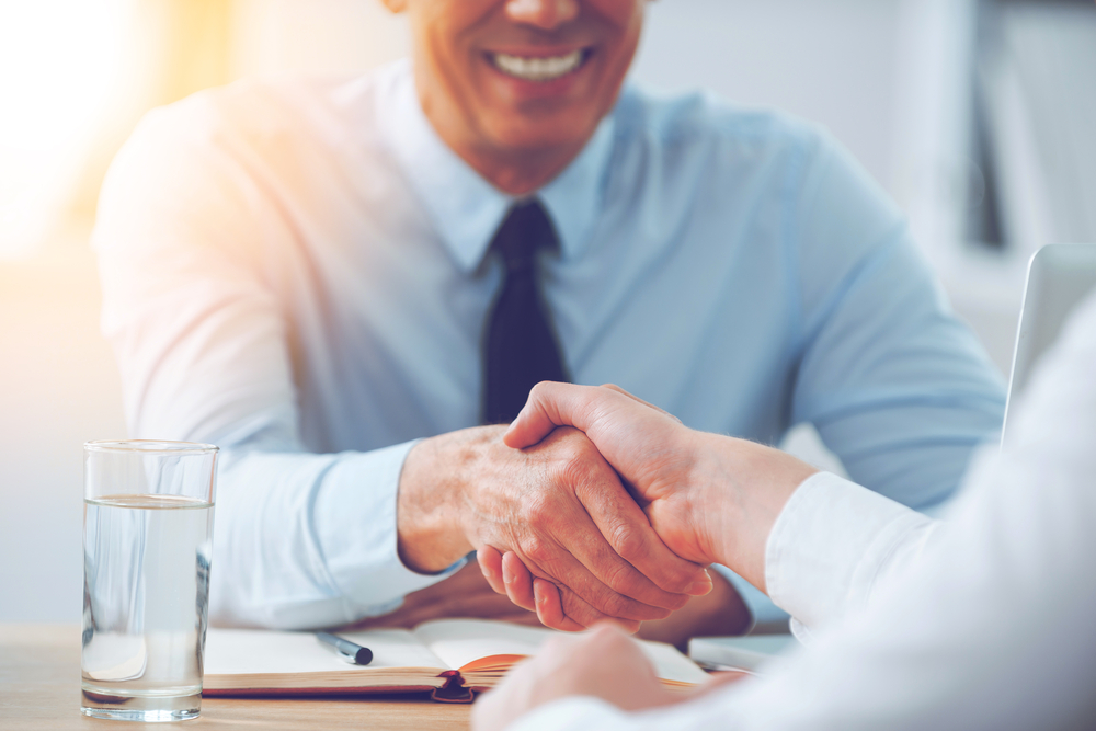 Franchisor and franchisees shaking hands