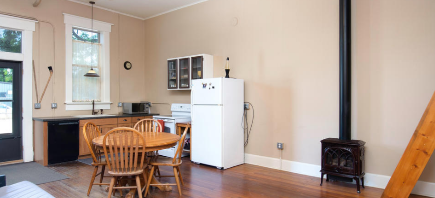 Interior image of a home with a table and stove
