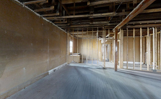 Photo of unfinished space with wooden beams and blank walls