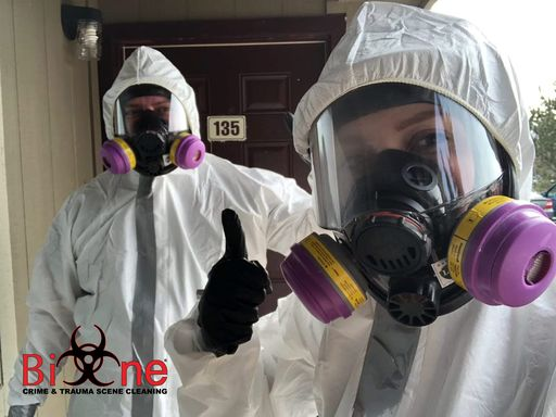 Image shows Bio-One technicians in full protective gear.
