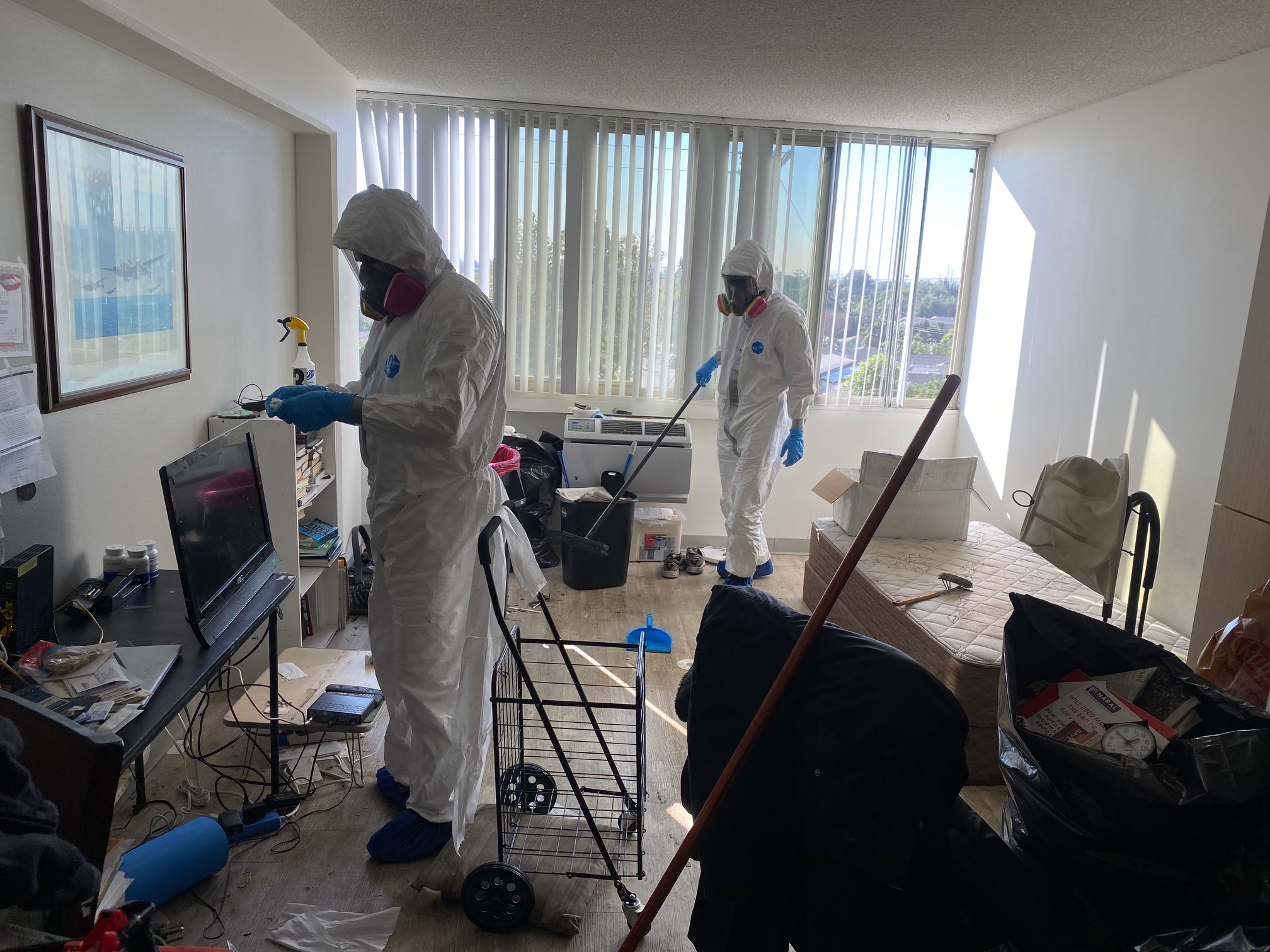 Bio-One of Orange technicians cleaning an appartment.