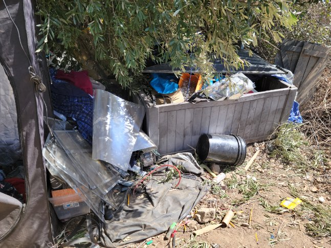 Homeless encampments often contain hazardous materials and waste that should be cleaned by professionals.