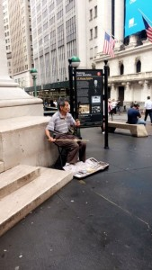 A daily concert on the corner of Wall Street.