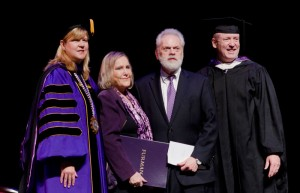 Furman president Elizabeth Davis and trustee Mike Riordan presented the Bell Tower Award to Rubye and Wayne Reid (center).