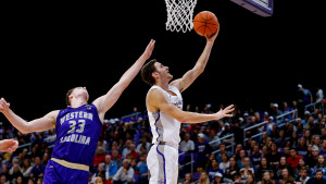 Furman forward Clay Mounce '21 scores a basket against Western Carolina.