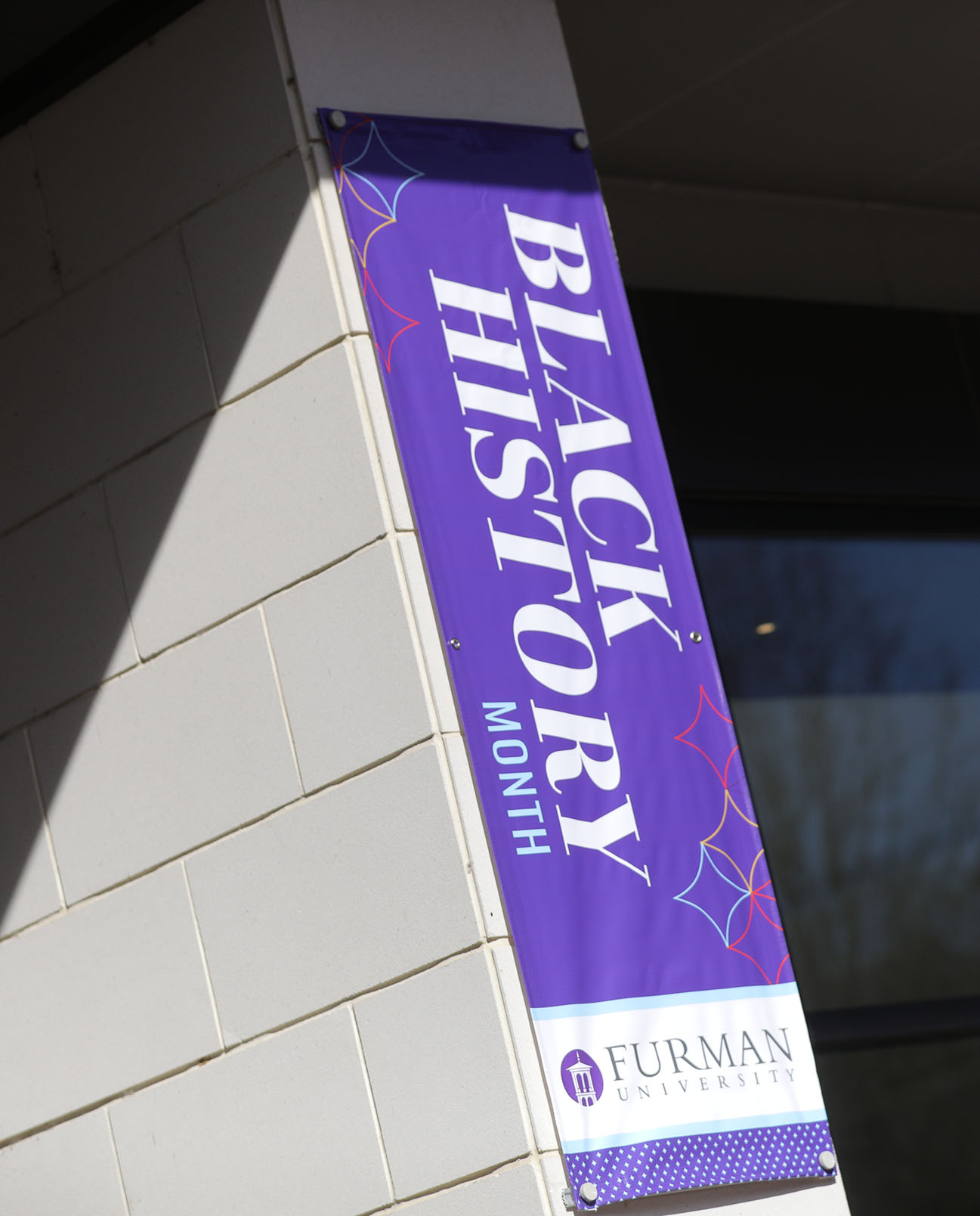 A Black History Month banner hanging at the Trone Student Center