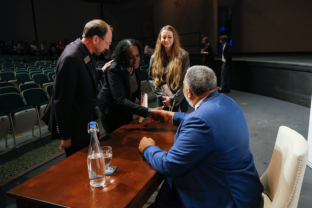 Anthony Ray Hinton shakes hands with a member of the audience