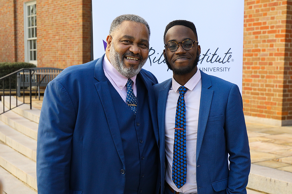 Anthony Ray Hinton, left, poses with Jonathan Kubakundimana '16 of the Equal Justice Initiative