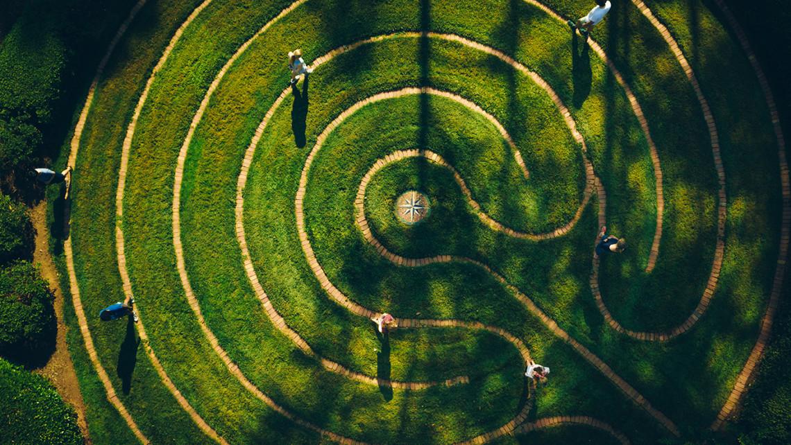 Mindfulness students perform a silent mediation walk around Furman's labyrinth behind Daniel Chapel.