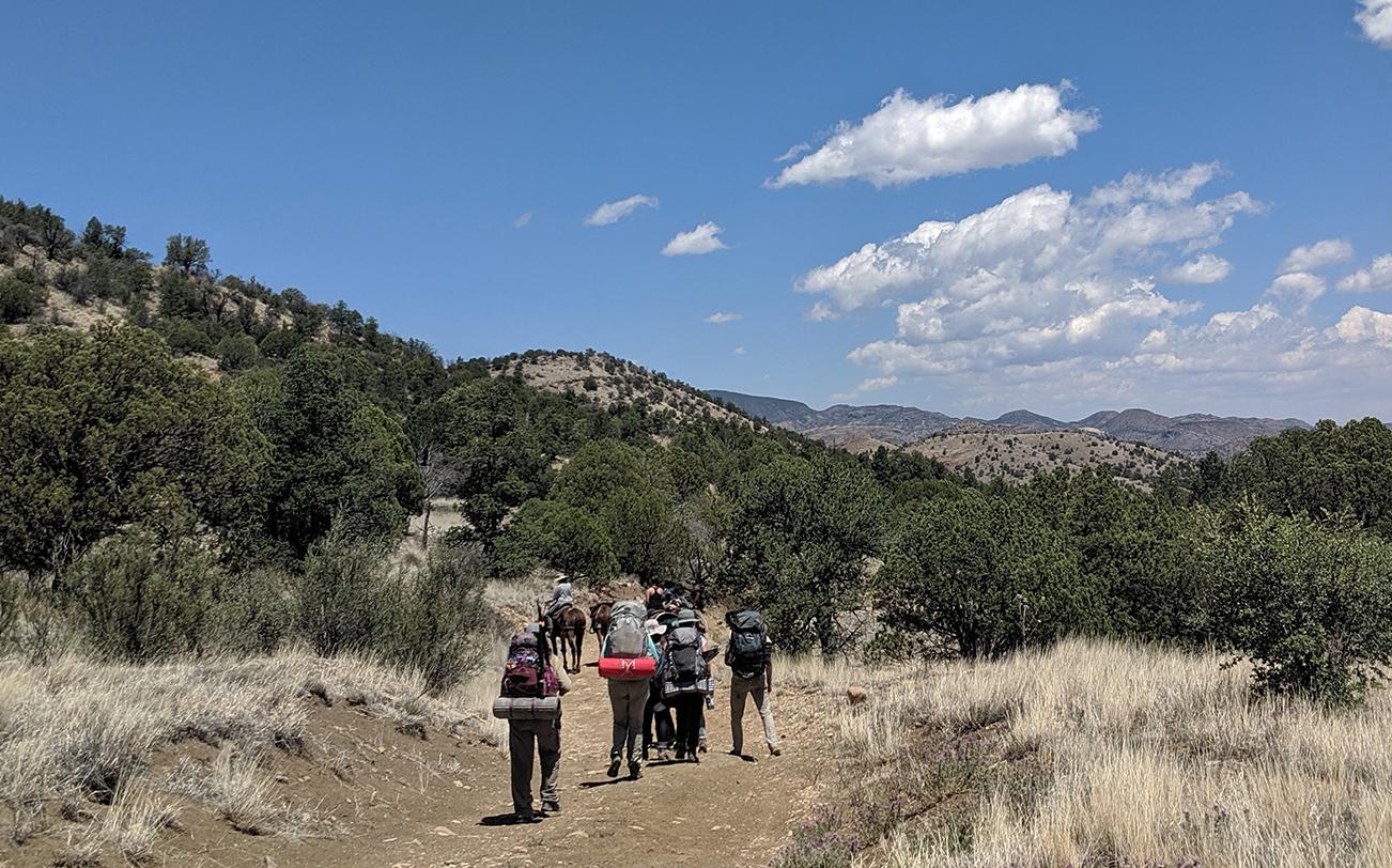 Students walk into the Aldo Leopold Wilderness.