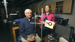 Bill Baker and Paige Ouzts hold picture taken by optical glucometer