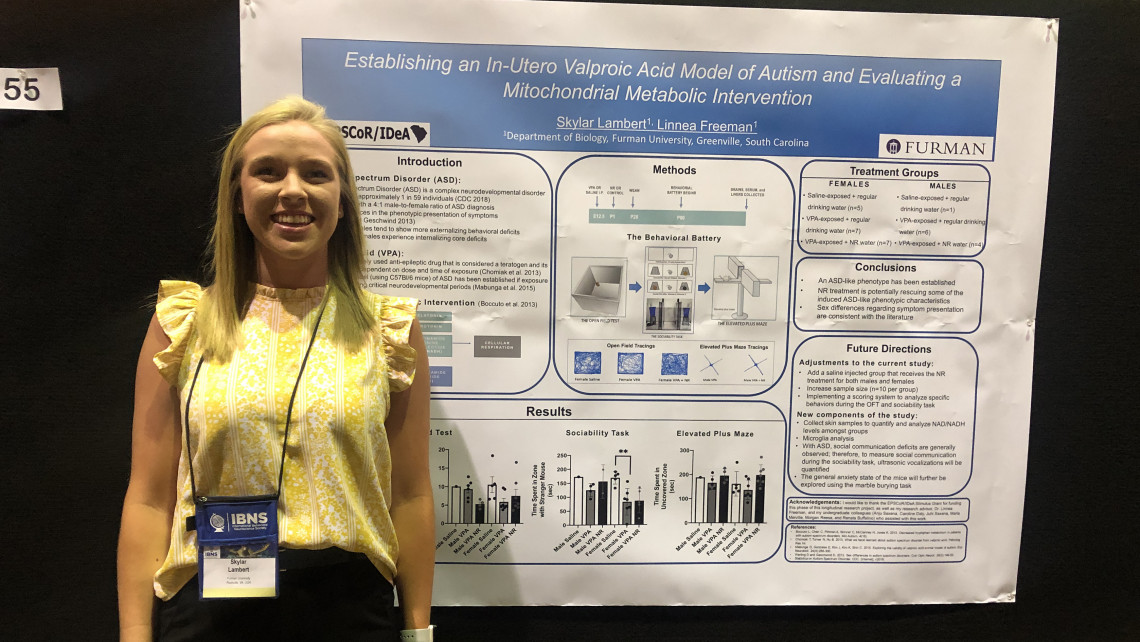 Skylar Lambert '19 stands next to her poster at the 2019 IBNS conference after she won an autism research award.