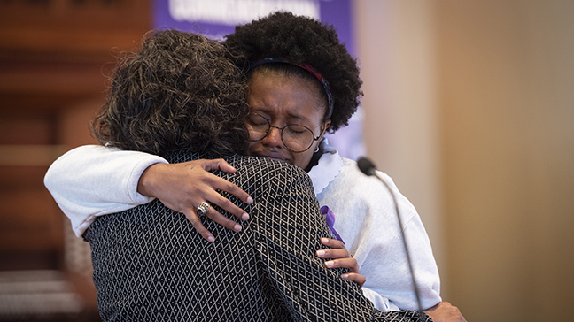 Adare Smith '20 and Lillian Brock Fleming '71 embrace during Joseph Vaughn Day