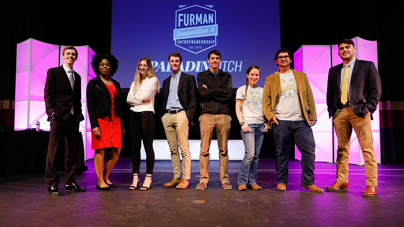Paladin Pitch competition competitors stand on stage