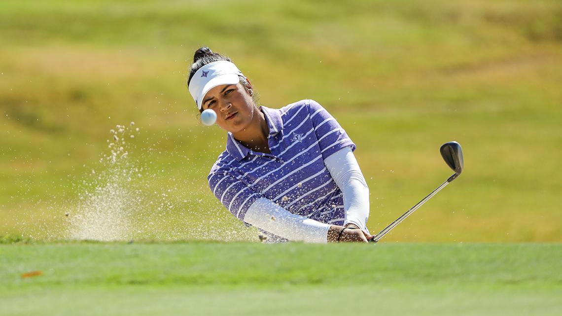Natalie Srinivasan '20 hits a golf ball out of a sand trap