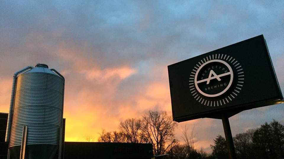 The Archetype Brewing sign at sunset