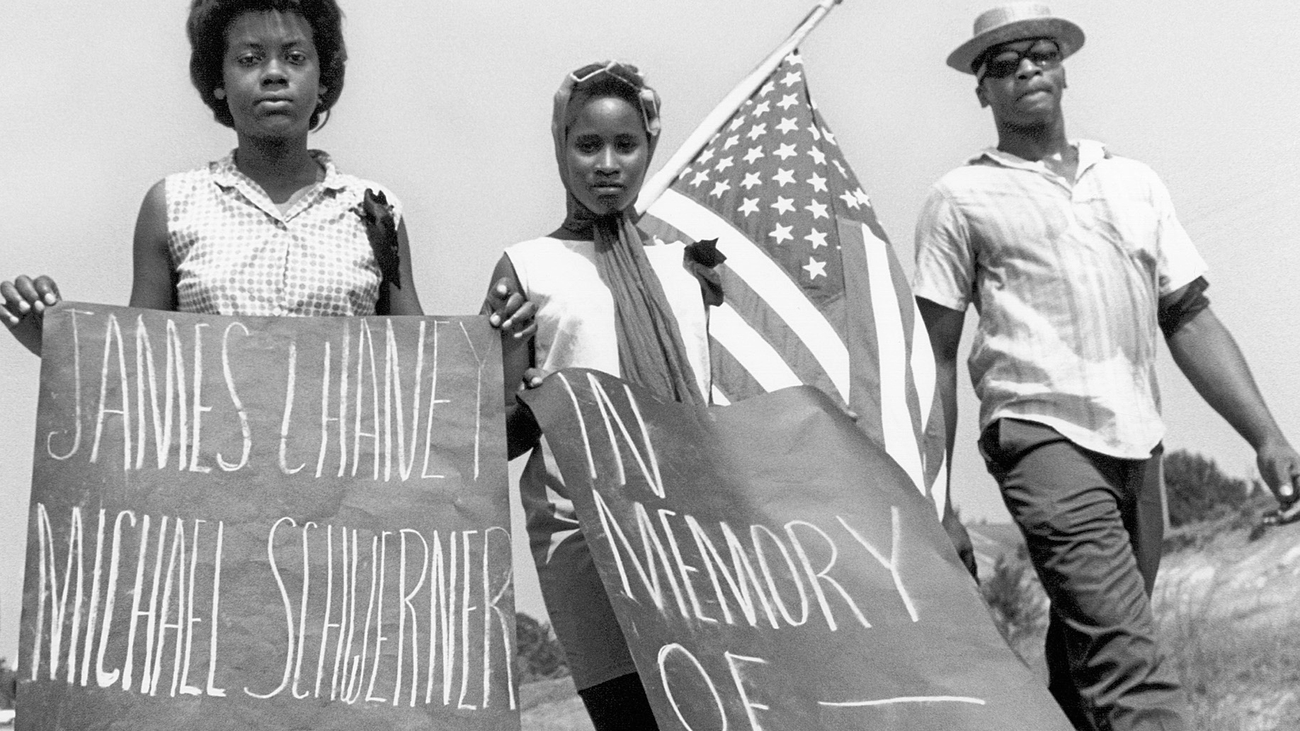 Photo from a book cover of three young black people protesting in the 1960s.