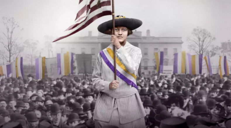 20th century woman holding flag